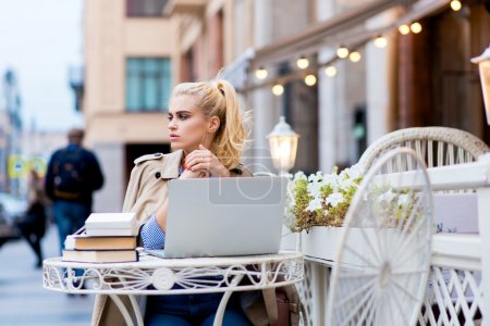 Woman resting after work on net-book