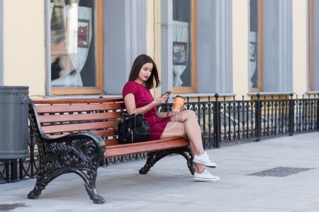 Young hipster girl using mobile phone