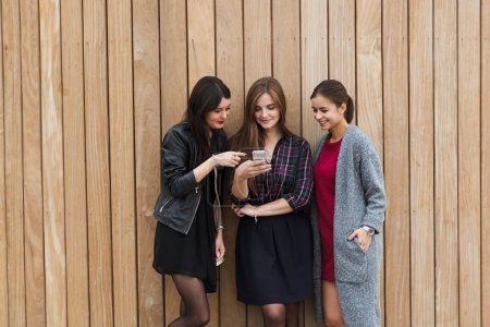 Tree ladies using smart phone