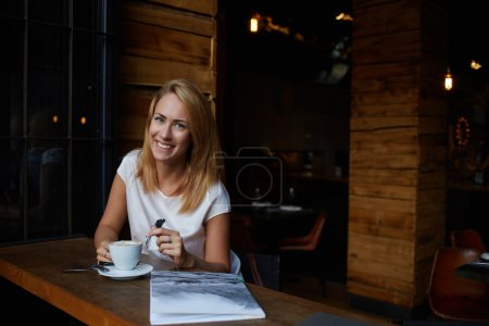 Attractive woman enjoying cup of coffee