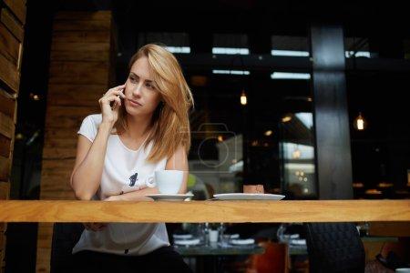Woman having mobile phone conversation