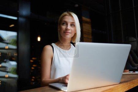 Elegant businesswoman working on laptop computer