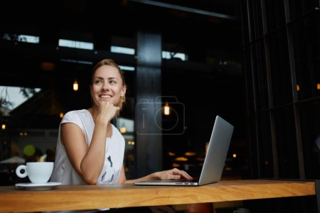 Woman working on portable net-book