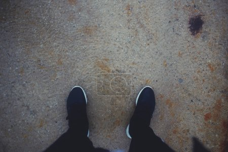 Man's legs in running shoes