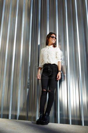 Model in black sunglasses posing outdoors