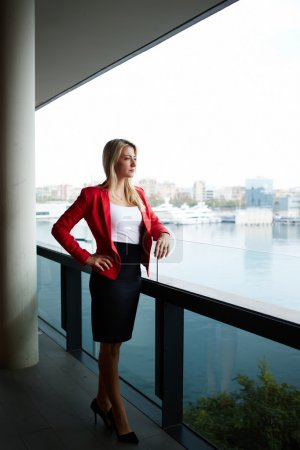 Businesswoman standing on the balcony terrace