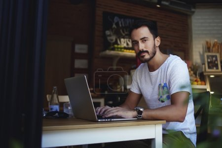man freelancer working on laptop computer
