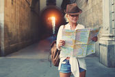 female tourist exploring location map