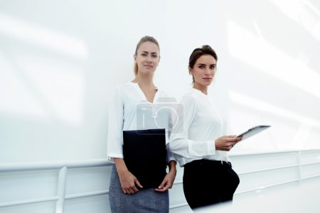women with touch pad and folder documents