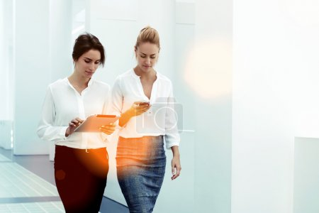 businesswomen with smart phone and touch pad