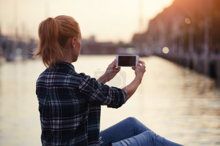 woman making photo with mobile phone