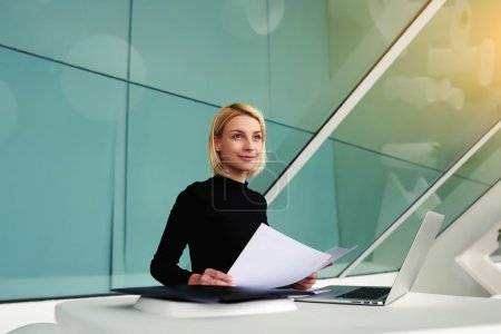 businesswoman holding paper documents