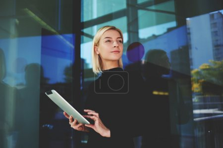 Young businesswoman holding touch pad