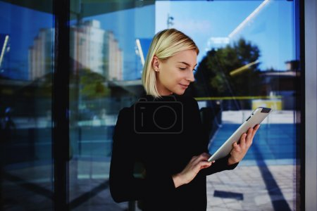 Young businesswoman working on touchpad
