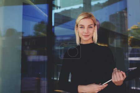 businesswoman holding touch pad