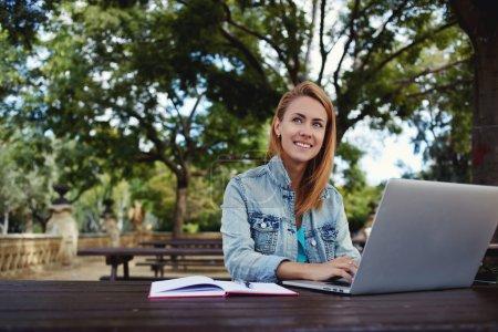 woman preparing coursework on laptop