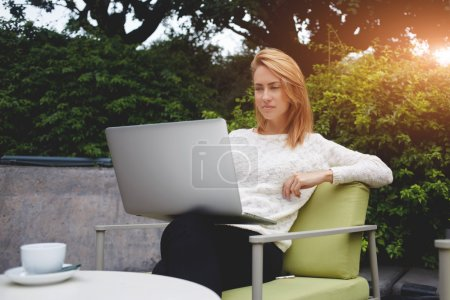 woman watching video on laptop