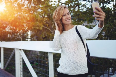 woman making photo on mobile phone
