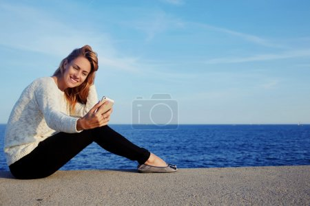 woman taking picture via mobile phone