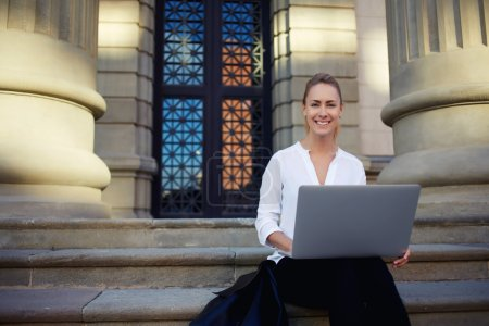 female student learning via laptop