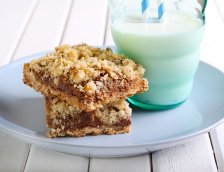 Photo for Chocolate and caramel oat bars and glass of milk - Royalty Free Image