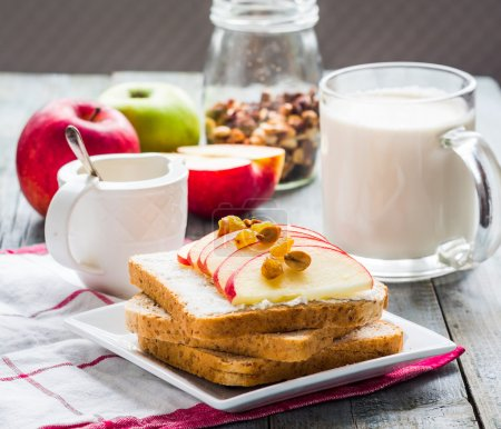 Photo for Bran toast with cheese, apple and dried fruits, healthy breakfast, clea - Royalty Free Image