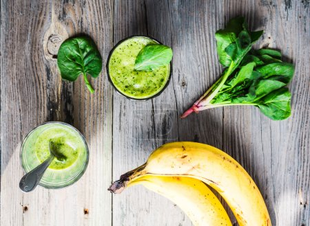 Photo for Vitamin green smoothie with spinach, banana, clean eating - Royalty Free Image