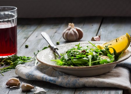 Photo for Green salad with arugula, cheese, almonds, lemon, garlic, snack, clean eating - Royalty Free Image