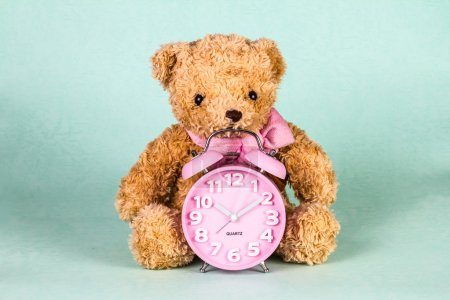 Retro and vintage style of Old fashioned alarm clock and cute doll
