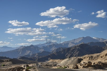Scenic view of mountain road with majestic mountains backgound