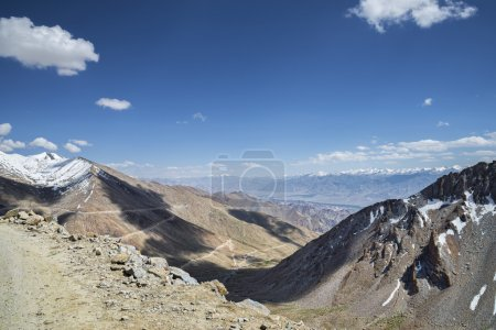 Aerial view to serpentine road, mountain range and valley of Leh from road to Khardung La pass