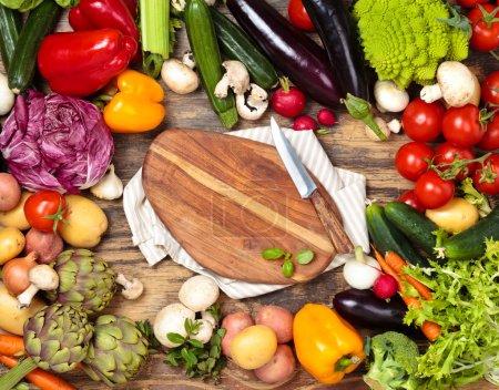 Fresh vegetables on wooden background.