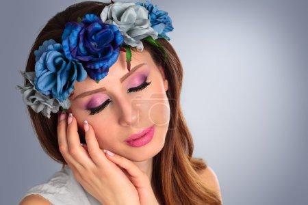Beautiful woman wearing wreath.