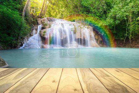Photo for Scenery of Erawan waterfall montage with wood floors. - Royalty Free Image