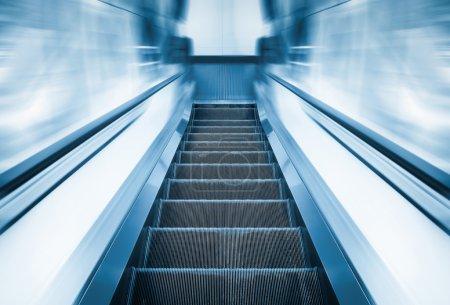 Escalator machine, blue color tone....