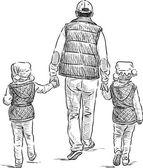 Padre con le sue figlie su una passeggiata