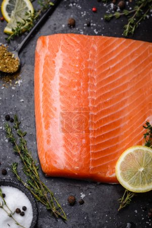 Photo for Raw salmon fillet with herbs, lemon and spice - Royalty Free Image