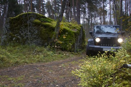 Jeep Wrangler in the autumn forest, Russia