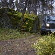 Постер, плакат: Jeep Wrangler in the autumn forest Russia
