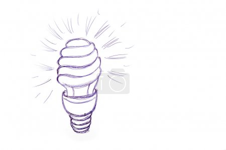 Figure energy saving light bulb on a sheet of paper