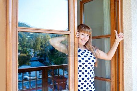 Beautiful girl at the window