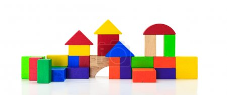 Building blocks toy over floor, isolated on white background