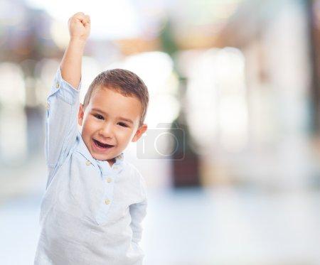 Little boy with winner gesture
