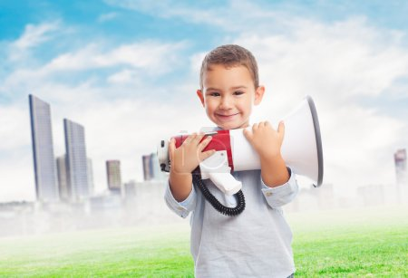 Little boy holding megaphone