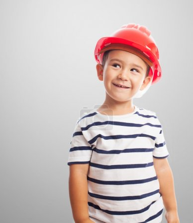 Little boy wearing mason helmet