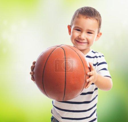 Little boy holding basket ball