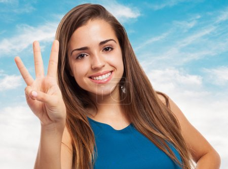Photo pour Portrait of pretty young woman counting with her fingers - image libre de droit