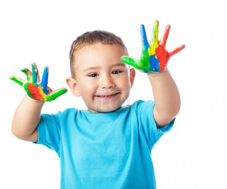 Cute kid with hands paint