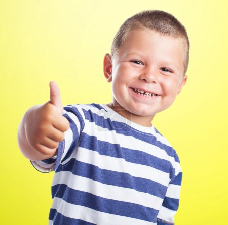 Cute kid doing positive sign