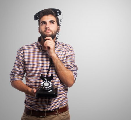 Man with telephone on head
